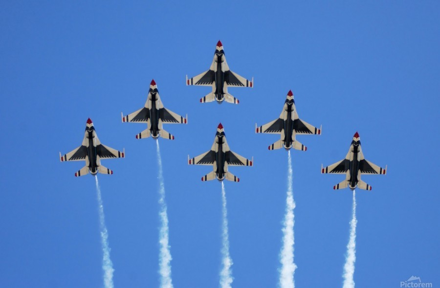 The U.S. Air Force Thunderbirds perform a 6-ship formation flyby during an air show.  Print