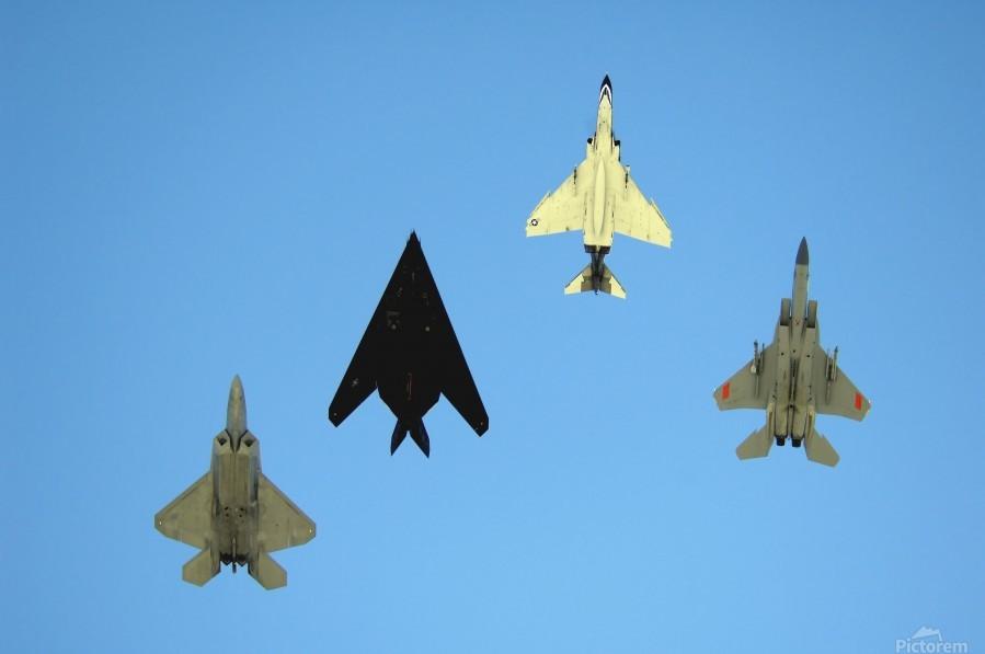 An F-22 Raptor an F-117 Nighthawk an F-4 Phantom and an F-15 Eagle in flight.  Print