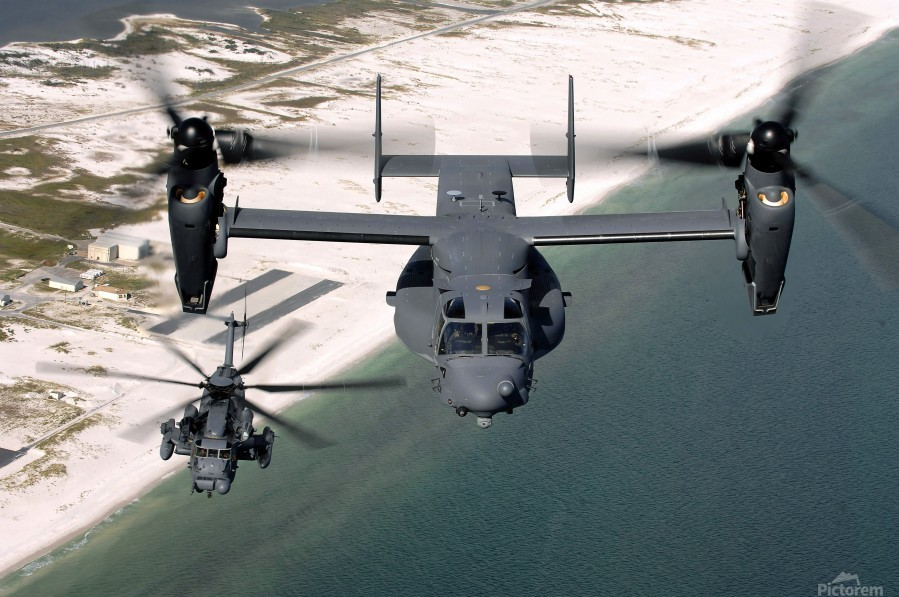 A CV-22 Osprey and an MH-53 Pave Low fly over the coastline of Florida.  Print