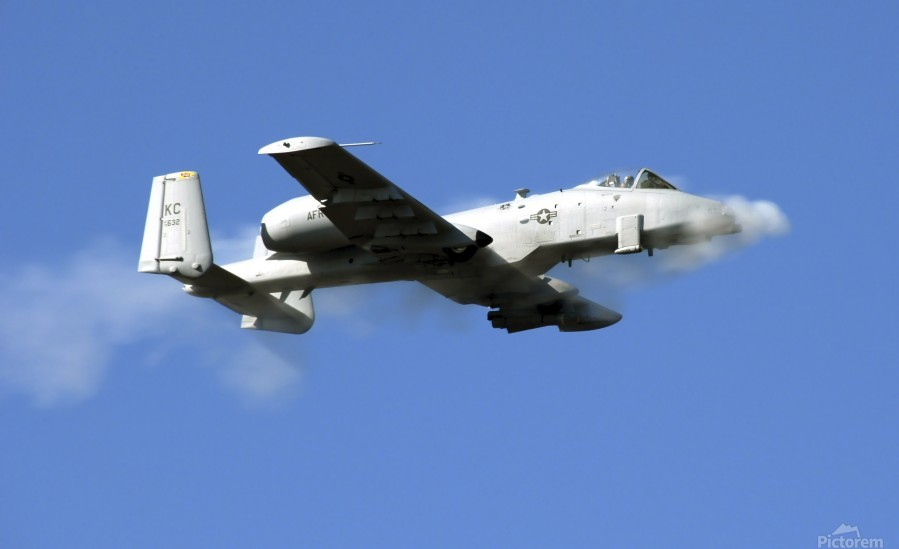 An A-10 Thunderbolt II pilot fires the planes 30-mm cannon.  Print
