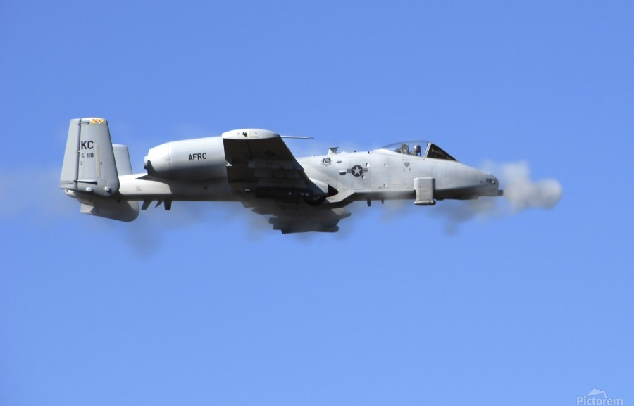 A pilot in an A-10 Thunderbolt II fires the planes 30-mm cannon.  Print