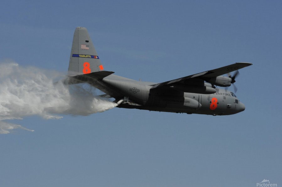 A U.S. Air Force C-130 Hercules releases its payload of water during training over South Carolina.  Print
