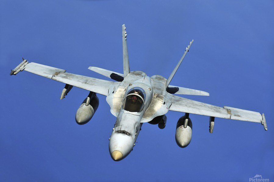 A F-A-18 Hornet participates in a mission in support of Rim of the Pacific.  Print