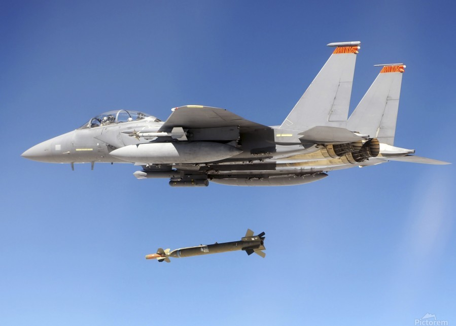 An F-15E Strike Eagle drops a GBU-28 bomb during a Combat Hammer mission.  Print