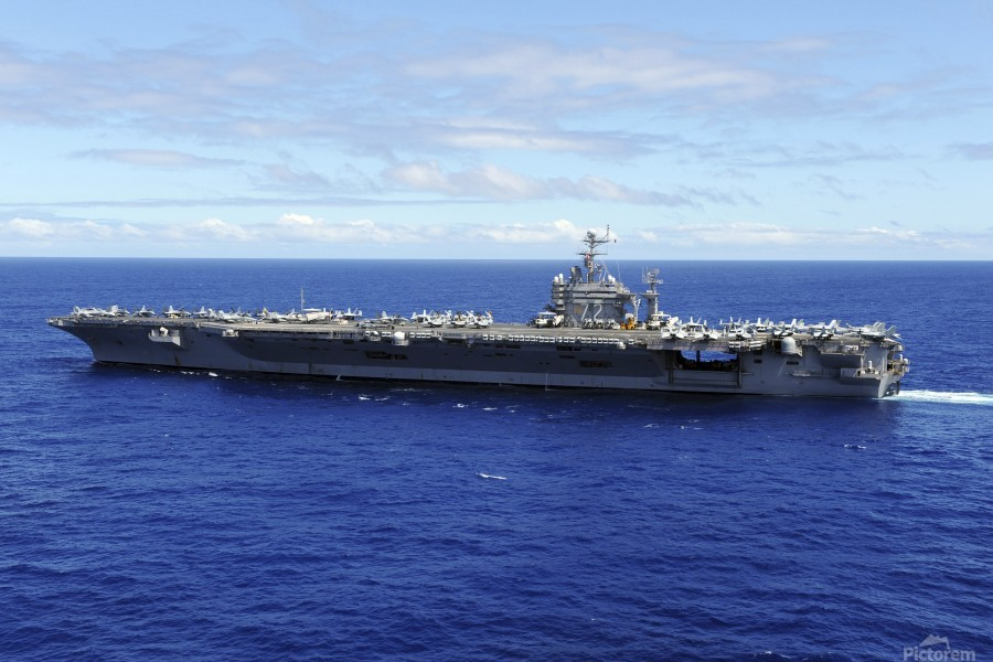 The aircraft carrier USS Abraham Lincoln transits across the Pacific Ocean.  Print