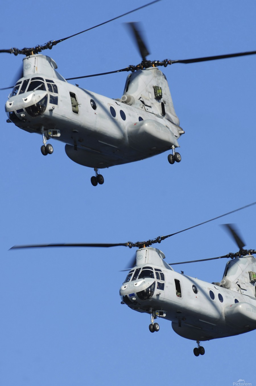Two U.S. Marine Corps CH-46E Sea Knight helicopters in flight.  Print