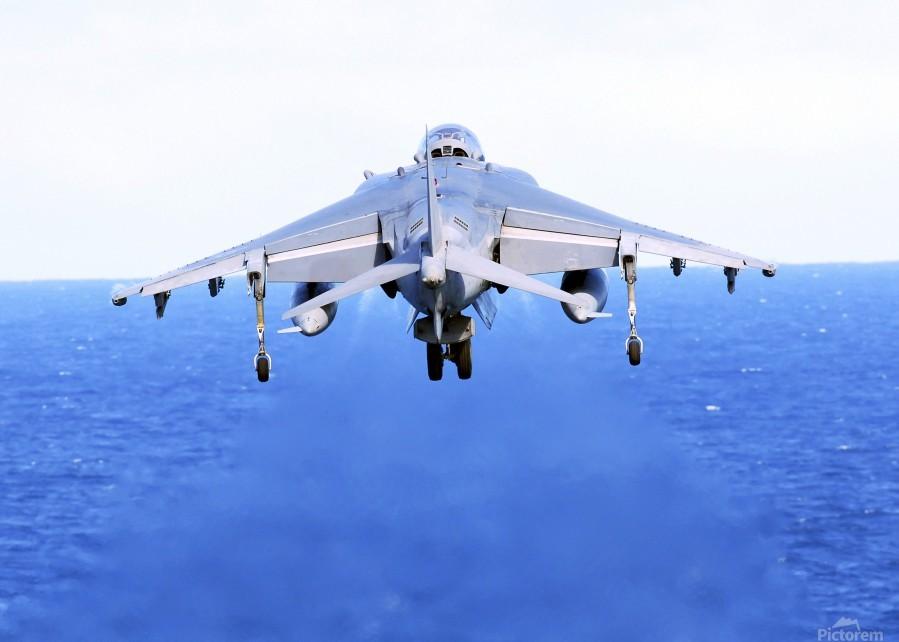 An AV-8B Harrier jet launches off the flight deck of USS Peleliu.  Print