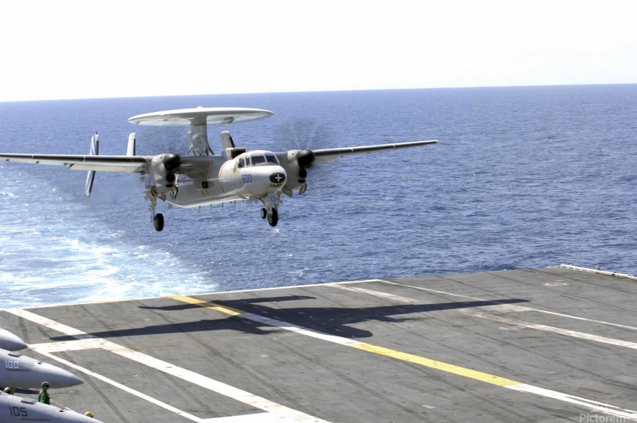 An E-2C Hawkeye makes its approach to the flight deck of USS Dwight D. Eisenhower.  Print