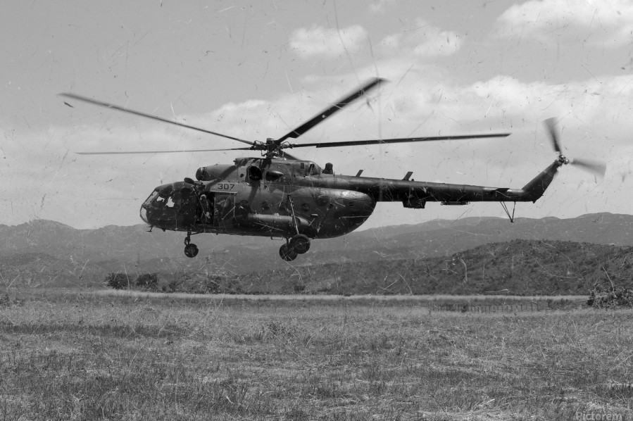 A Macedonian MI-17 helicopter landing as part of a medical transport flight.  Print