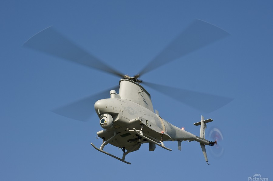 An MQ-8B Fire Scout unmanned aerial vehicle in flight.  Print