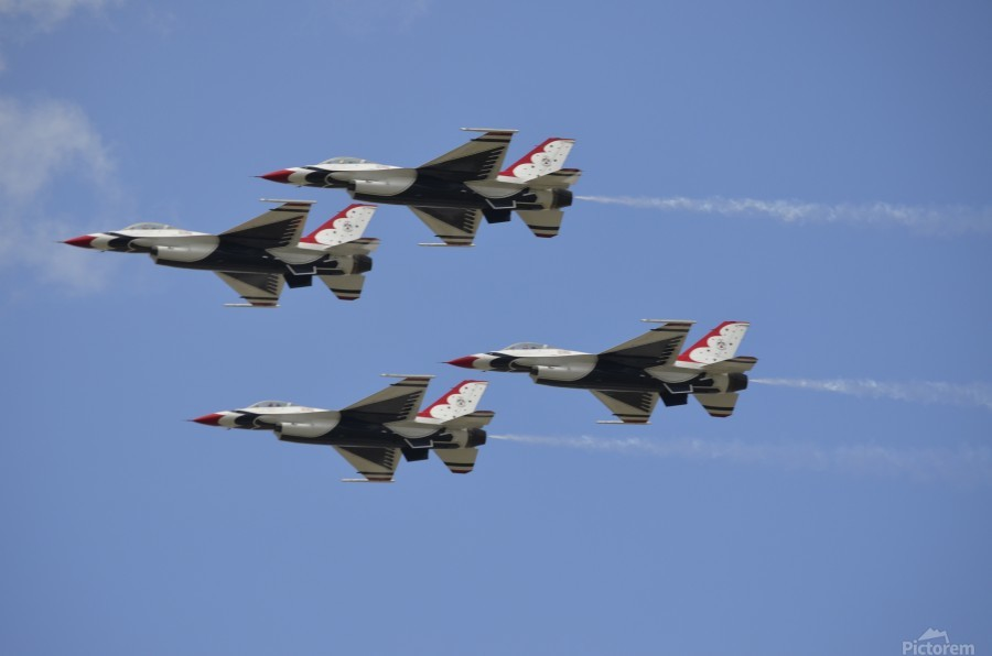 The U.S. Air Force Thunderbirds fly in formation.  Print