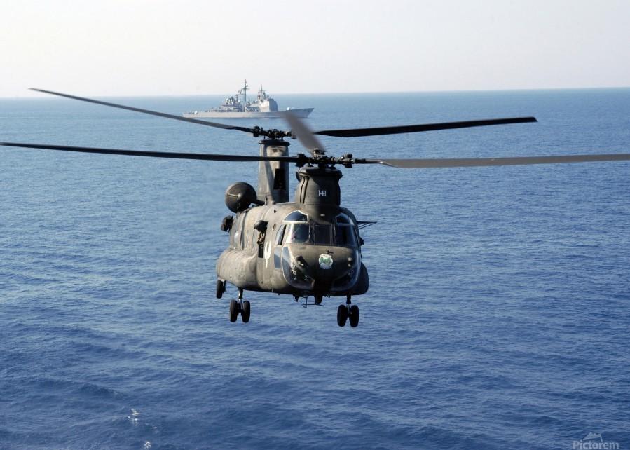 A U.S. Army MH-47 Chinook prepares to land.  Print