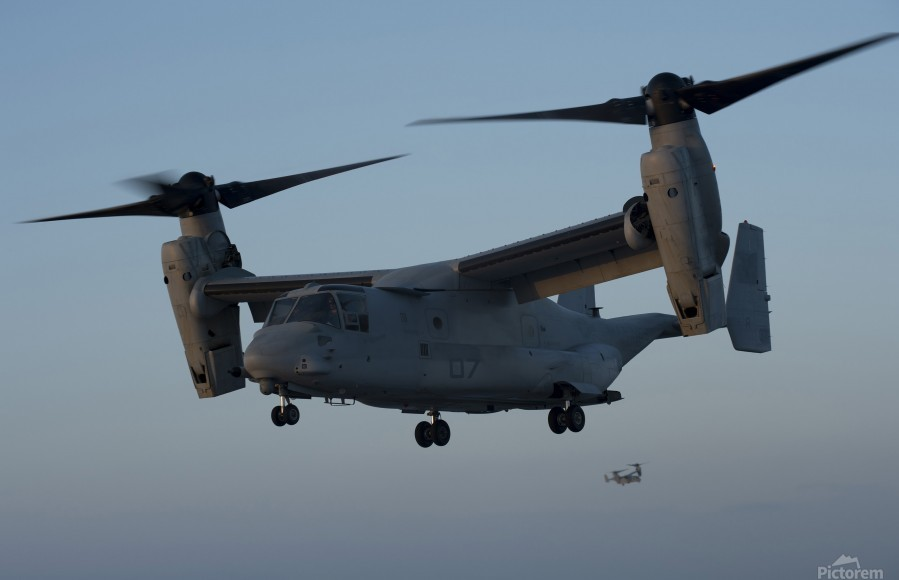 An MV-22 Osprey prepares to land on the flight deck of USS Anchorage.  Print