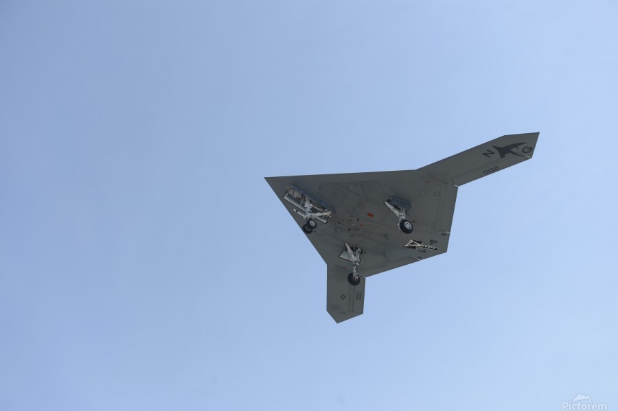 An X-47B unmanned combat air system in flight.  Print