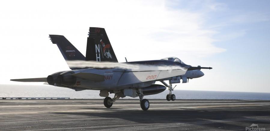 An F-A-18E Super Hornet touches the flight deck of USS Nimitz.  Print