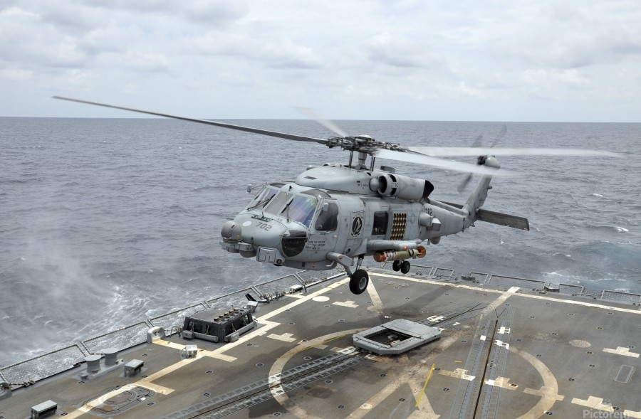 An MH-60R Sea Hawk helicopter lifts off from USS Wayne E. Meyer.  Print