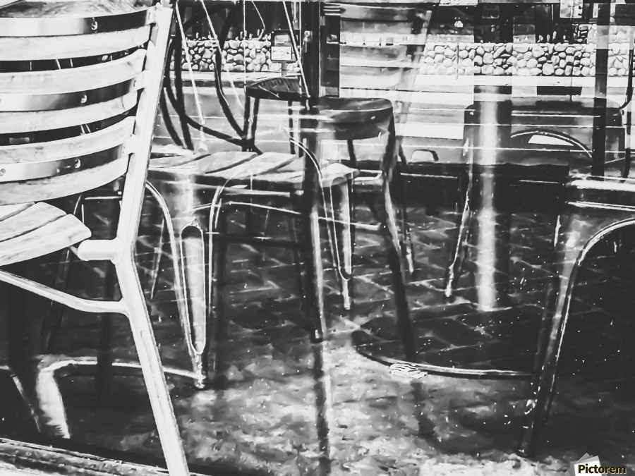 outdoor chairs in the city in black and white  Print