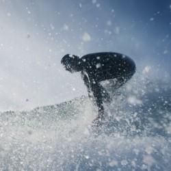 A Man Surfing Off Bunker Beach; Tarifa, Cadiz, Andalusia, Spain
