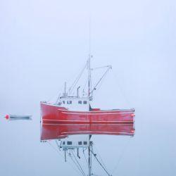 New Brunswick - fishing boat reflected in water
