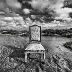 Chair in pool of water - B&W version