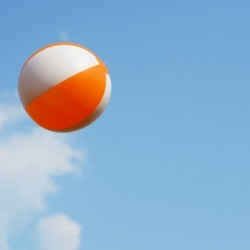 Beach ball on top of cloud