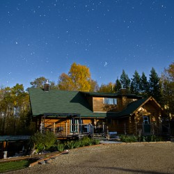 Nightscape Over Log Cabin