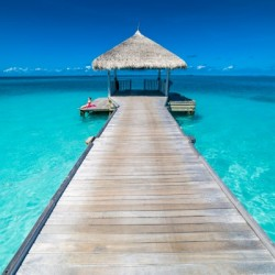 View of water bungalow in tropical island, Maldives, Indian ocean