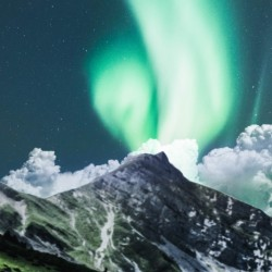 Aurora Borealis Over The Mountain
