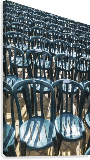 Plastic green chairs lined up in rows; Malaga Province, Andalusia, Spain  Canvas Print