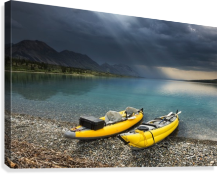 a pair of yellow inflatable kayaks on the lower twin lake beach with