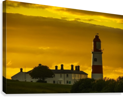 Souter Lighthouse under a glowing golden sky at sunset; South Shields, Tyne and Wear, England  Canvas Print