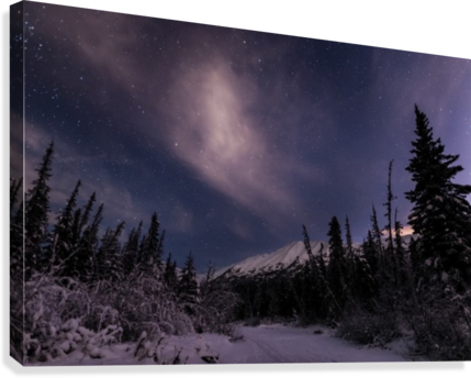 Night skies above Chugach Mountains and Eagle River Valley on winter solstice in South-central Alaska; Alaska, United States of America  Canvas Print