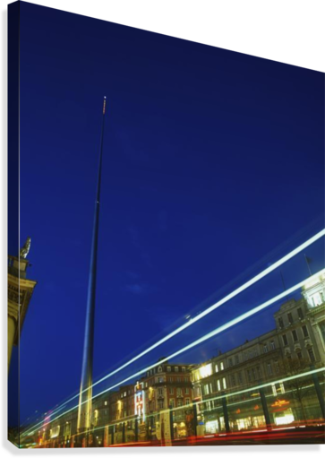 Spire Of Dublin, O'connell Street, Dublin, Ireland; Sculpture Against Traffic Light Streams  Canvas Print