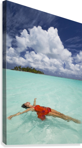 French Polynesia, Woman Floating In Ocean Water.  Canvas Print