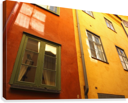Low Angle View Of Red And Yellow Painted Buildings; Stockholm, Sweden  Canvas Print