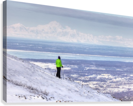 Woman snowshoer taking in the view of Mt. McKinley (Denali) from Blueberry Hill at the Glen Alps area of Chugach State Park, Anchorage, Southcentral Alaska, Winter, HDR  Canvas Print