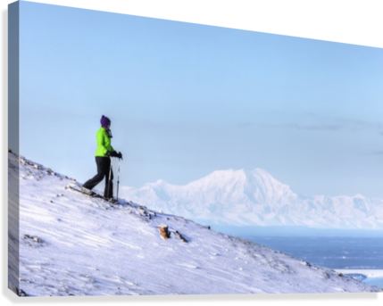 Woman snowshoeing on Blueberry Hill at the Glen Alps area of Chugach State Park with Mt. Foraker in the background, Anchorage, Southcentral Alaska, Winter, HDR  Canvas Print