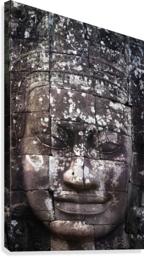 A face sculpture on a stone wall at angkor wat;Cambodia  Canvas Print