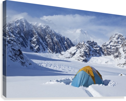 Mountain tent on ridge in winter, Mt. McKinley in background, part of Mt. Dan Beard immediately behind tent, Denali National Park and Preserve; Alaska, United States of America  Canvas Print