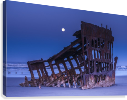 The moon sets over the wreck of the Peter Iredale; Oregon, United States of America  Canvas Print