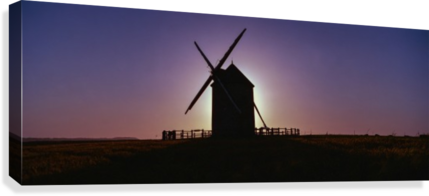 Windmill against the sunset north west France.  Canvas Print