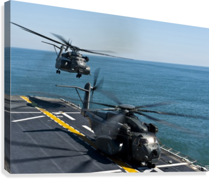 MH-53E Sea Dragon helicopters take off from the flight deck of USS Wasp.  Canvas Print