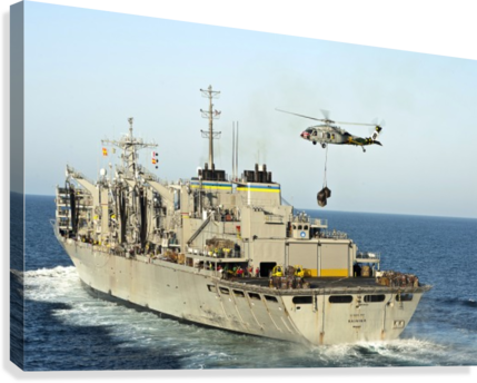 An MH-60S Knighthawk lifts cargo from the fast combat support ship USNS Rainier.  Canvas Print
