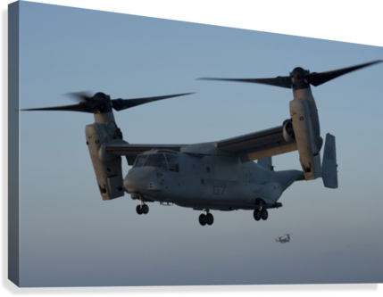 An MV-22 Osprey prepares to land on the flight deck of USS Anchorage.  Canvas Print