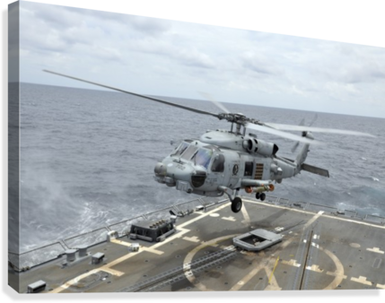 An MH-60R Sea Hawk helicopter lifts off from USS Wayne E. Meyer.  Canvas Print