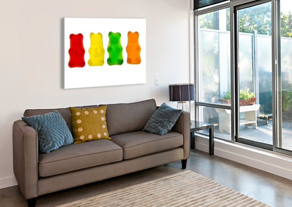 COLOURFUL CANDIED GUMMY BEARS IN A ROW BACKLIT; CALGARY, ALBERTA, CANADA PACIFICSTOCK  Canvas Print