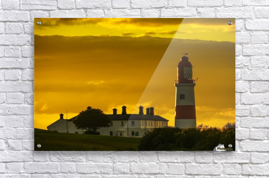 Souter Lighthouse under a glowing golden sky at sunset; South Shields, Tyne and Wear, England  Acrylic Print