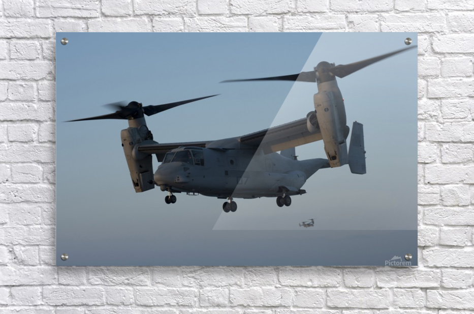 An MV-22 Osprey prepares to land on the flight deck of USS Anchorage.  Acrylic Print