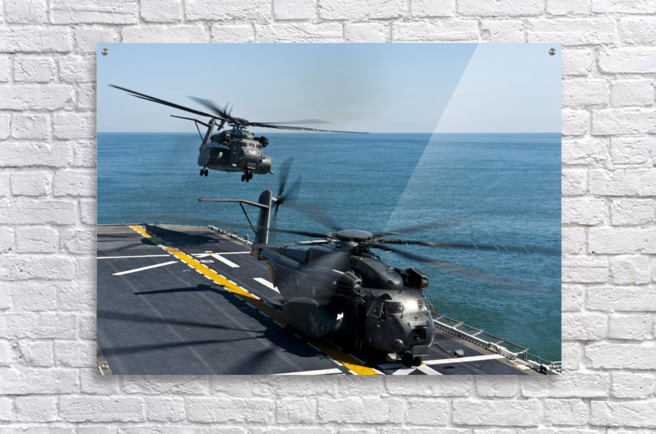 MH-53E Sea Dragon helicopters take off from the flight deck of USS Wasp.  Acrylic Print