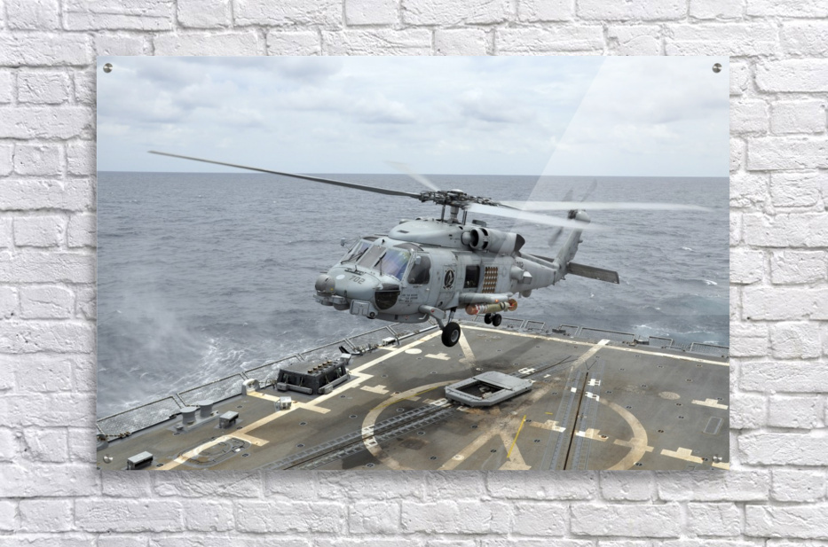 An MH-60R Sea Hawk helicopter lifts off from USS Wayne E. Meyer.  Acrylic Print
